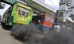 A commuter bus running on diesel fuel emits thick trail of pollutants in Jakarta. New research shows that when people understand that humans are causing global warming, they're more likely to be concerned about the problem.