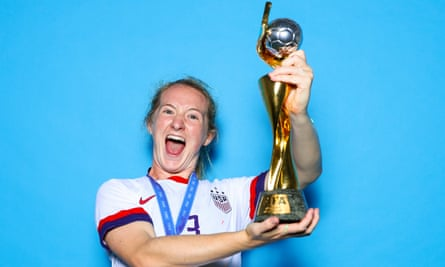 Sam Mewis holds the Women's World Cup after the US victory in France in 2019