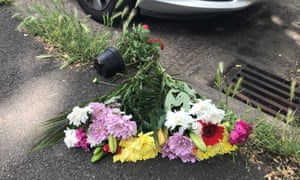 Flowers left at the scene where a man was stabbed in Wandsworth.