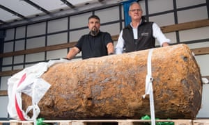 Dieter Schwetzler, left, and Rene Bennert of the explosive ordnance disposal division stand behind the second world war bomb they defused.