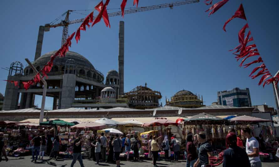 Construction continues on Istanbul's new Taksim Mosque. But locals say residential construction has stopped as a result of financial uncertainty.