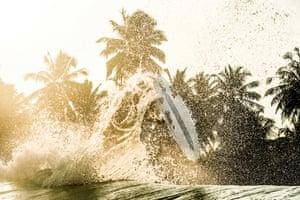 A surf board flying through the air.