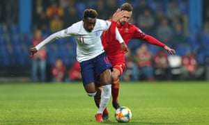 Callum Hudson-Odoi challenged by Montenegro's Marko Vesovic during England's 5-1 win.