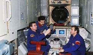 Faris (centre) on board Mir.
