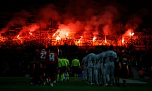 Young Boys fans set off flares as the players take to the field.
