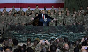 Donald Trump speaks to the troops during a surprise Thanksgiving Day visit at Bagram air field in Afghanistan.