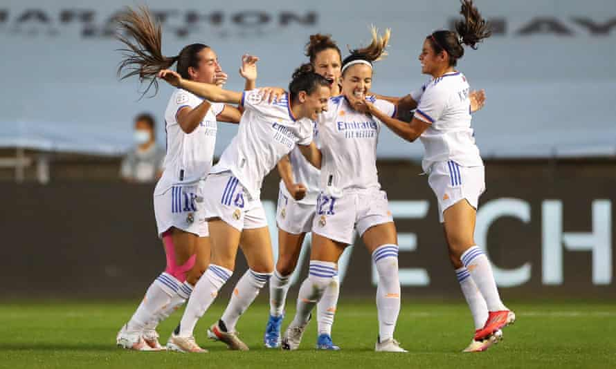 Real Madrid's Kosovare Allani and teammates celebrate victory against Manchester City.