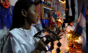 A Catholic child dressed as an angel participates in La Griteria in Nicaragua.
