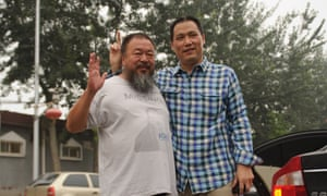 Human rights lawyer Pu Zhiqiang, right, pictured with Ai Weiwei, dissident artist and one of his clients, in Beijing in 2012. Pu is now on trial.