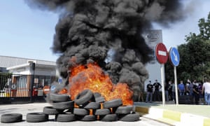 Tyres are burned during a protest in front of the Nissan factory in Barcelona, which is going to close.
