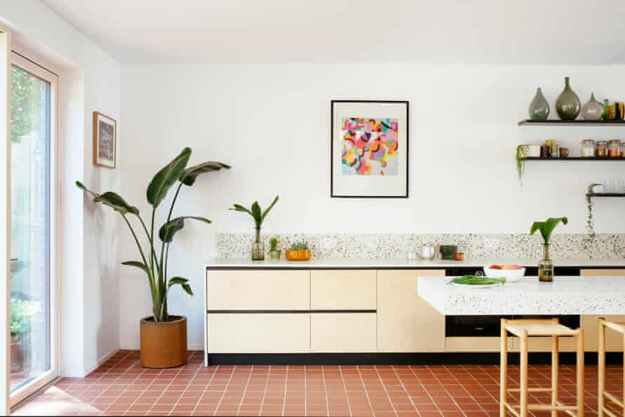 The kitchen, designed by local company West + Reid, is made from Valchromat, a colorful MDF.  Countertops are made from poured concrete mixed with aggregates.