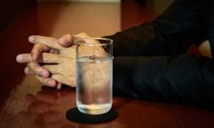 Glass of Shochu on a bar.