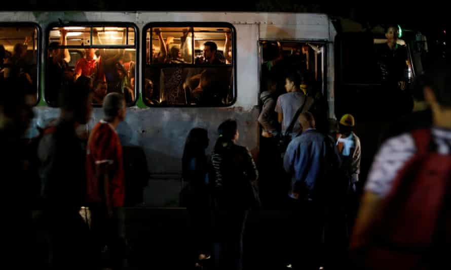 People get on a bus during the blackout.