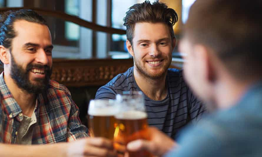 Men drinking in a pub