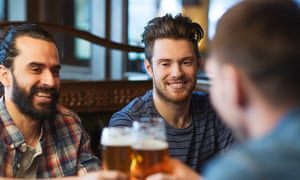 Men drinking in pub
