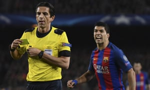 Luis Suárez reacts to being booked by the referee Guido Kleve for a dive during Barcelona's 6-1 win against PSG