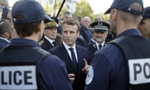 President Emmanuel Macron with police officers, 2017.