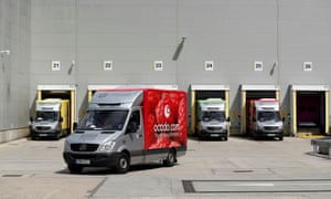 A delivery van leaving the dispatch area of the Ocado customer fulfilment centre in Andover