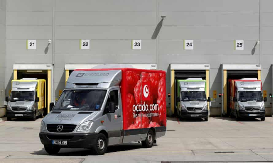 A delivery van leaves the dispatch area of the Ocado customer fulfilment centre in Andover.