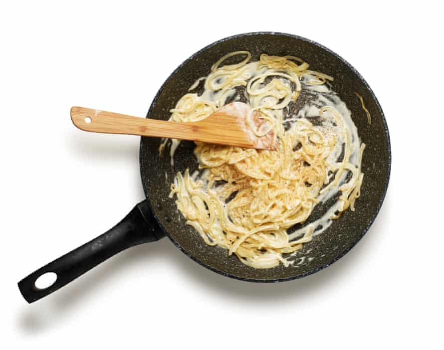 Felicity Cloake's Flammekuche 4. Frying onions and adding creme fraiche.