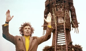 Christopher Lee with wicker man behind