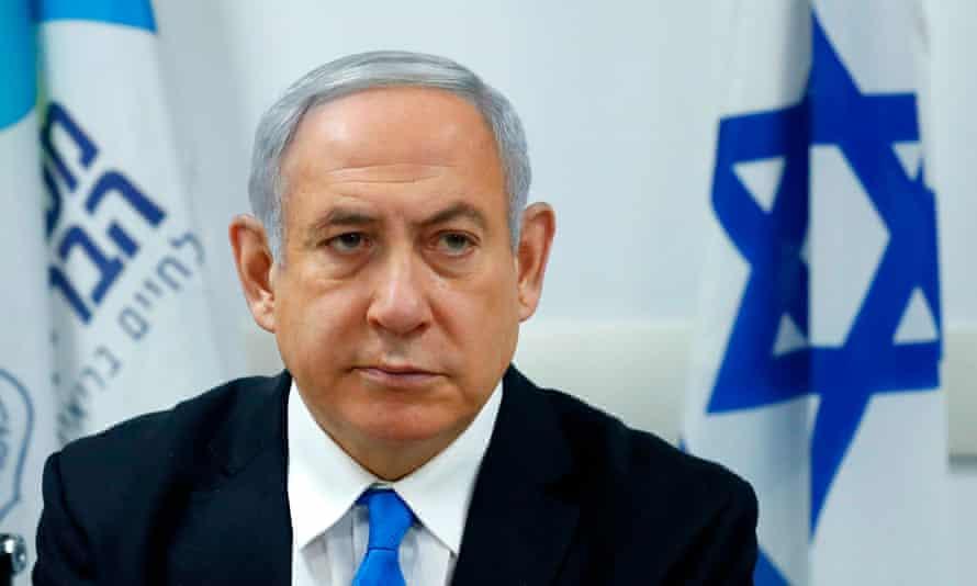 Benjamin Netanyahu in front of an Israeli flag