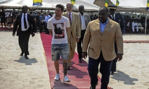 Lionel Messi (centre) is given a tour around the construction site of the Port-Gentil stadium.