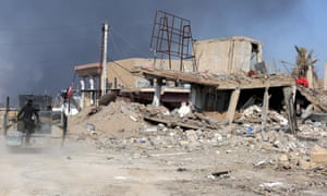 A destroyed building is seen near a government complex in Ramadi.