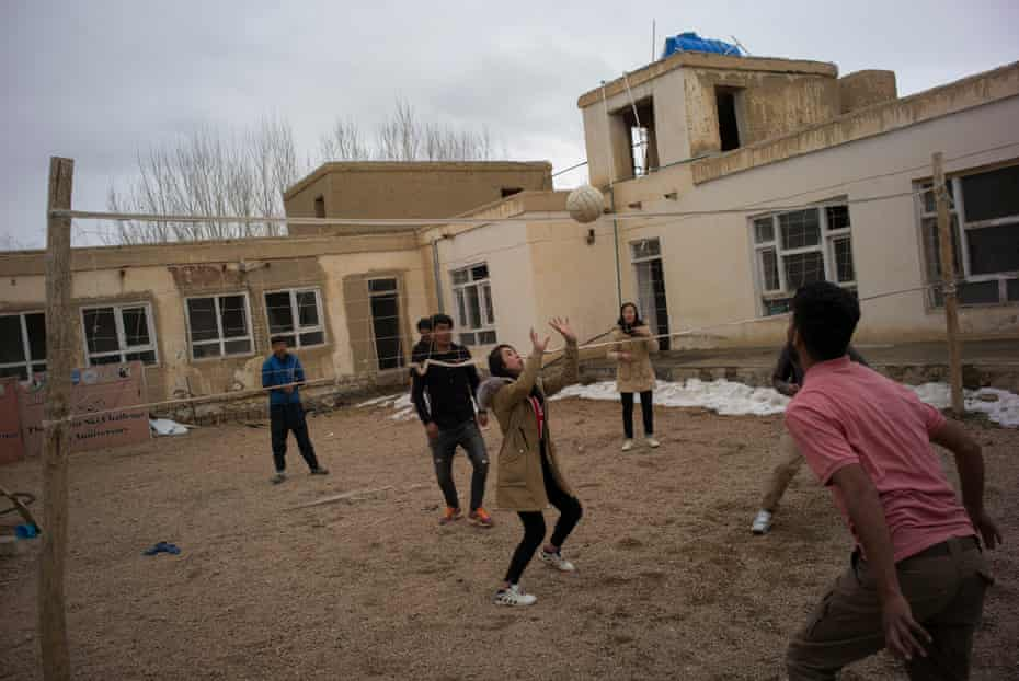 Members of the Bamyan Ski Club enjoy playing volleyball at their club house/offices in Bamyan.