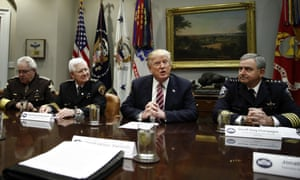 Donald Trump with Rockwall County sheriff Harold Eavenson, at left of president, during a roundtable discussion with members the National Sheriffs' Association in the White House on 13 February.
