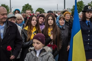 People attend a commemoration of the 30th anniversary of the Chernobyl nuclear accident in Kiev