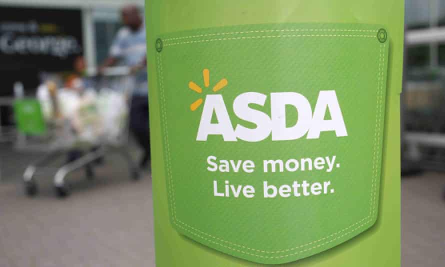 A customer leaves an Asda store in northwest London