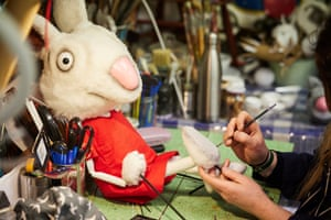 Judith Hope works on a mouse puppet