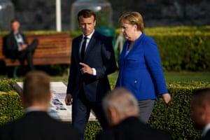 President Macron and Angela Merkel walk together in Jubelpark