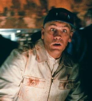 John Malkovich playing a version of himself in Being John Malkovich.