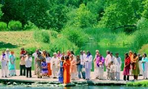Alice Coltrane Turiyasangitananda (in orange, centre) and devotees