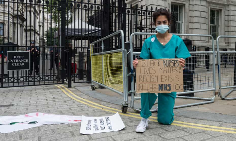 An NHS nurse protests outside Downing Street, London, 3 June 2020