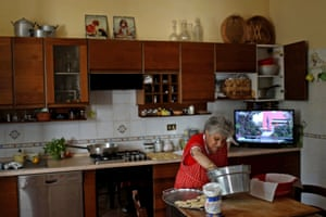 One of the village's inhabitants, 90-year-old Aida Cicci Cardelli cooks for a birthday dinner