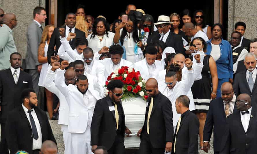 The casket for Philando Castile is carried from the cathedral after a funeral service in Minnesota.
