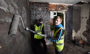Apprentices refurbish one of the properties in Goldthorpe, Barnsley, bought by local residents to provide jobs and housing.