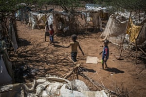 Children play in a makeshift camp near the town of Loruk in Baringo county, Kenya. Hundreds of locals have taken refuge in this tiny camp after gunmen shot and killed their neighbours in January
