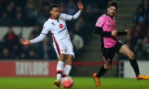 Josh Murphy slots home MK Dons' second.