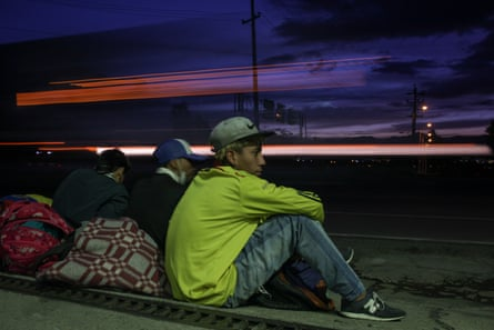 Venezuelans on their way to get back to their country wait by the roadside in Bogotá, Colombia.