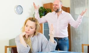 Woman signalling her angry partner to be quiet