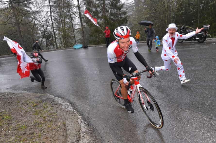 Simon Pellaud is cheered on by fans in the grim conditions.