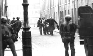 Edward Daly with white handkerchief on Bloody Sunday in Derry in 1972. 'I said a prayer with him and I anointed him and gave him the last rites. We decided to make a dash for it,' said the priest.