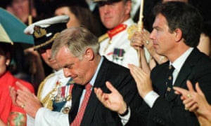 An emotional Chris Patten is applauded by Prince Charles and Tony Blair after speaking at the ceremony to hand Hong Kong back to China in 1997.
