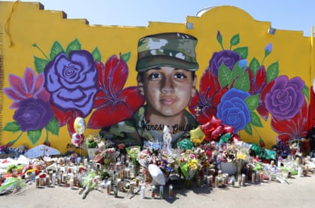 Offerings sit in front of a mural of the slain army specialist Vanessa Guillén painted on a wall in the south side of Fort Worth, Texas.