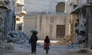 'Cities die just like people' … civilians in Aleppo, Syria.