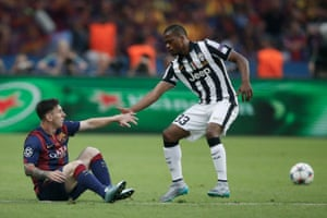 Patrice Evra helps Lionel Messi to his feet by during the 2015 Champions League final between Barcelona and Juventus.